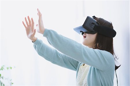 perception - Japanese woman using virtual reality device Stock Photo - Premium Royalty-Free, Code: 622-08519685