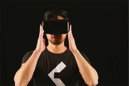 perception - Japanese man using virtual reality device Stock Photo - Premium Royalty-Free, Code: 622-08519697
