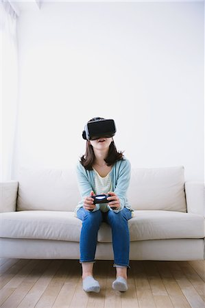 perception - Japanese woman using virtual reality device Stock Photo - Premium Royalty-Free, Code: 622-08519690