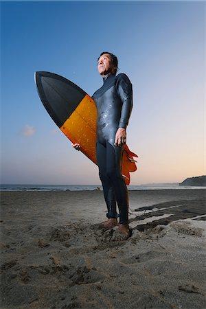 Japanese surfer portrait on the beach Stock Photo - Premium Royalty-Free, Code: 622-08512638