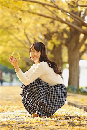 Young Japanese woman in a city park Stock Photo - Premium Royalty-Free, Code: 622-08542967