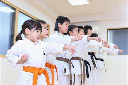 preteen models asian - Japanese kids karate class Stock Photo - Premium Royalty-Free, Code: 622-08657819