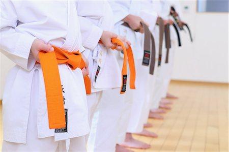 preteen girl feet - Japanese kids karate class Stock Photo - Premium Royalty-Free, Code: 622-08657810
