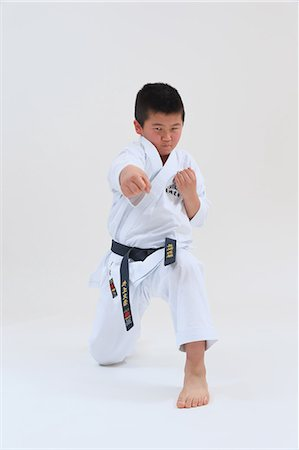 pre-teen boy models - Japanese kid in karate uniform on white background Stock Photo - Premium Royalty-Free, Code: 622-08657827