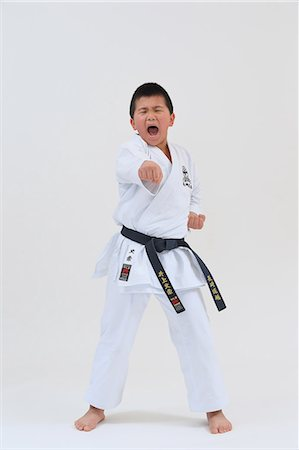 pre-teen boy models - Japanese kid in karate uniform on white background Stock Photo - Premium Royalty-Free, Code: 622-08657828