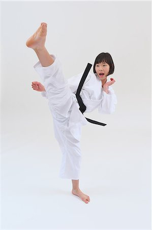 Japanese kid in karate uniform on white background Stock Photo - Premium Royalty-Free, Code: 622-08657822