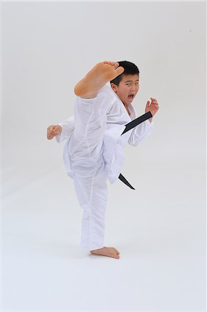foot model - Japanese kid in karate uniform on white background Stock Photo - Premium Royalty-Free, Code: 622-08657834
