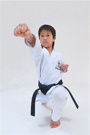 pre-teen boy models - Japanese kid in karate uniform on white background Stock Photo - Premium Royalty-Free, Code: 622-08657835