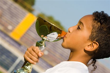 preteen kissing - Boy kissing a trophy Stock Photo - Premium Royalty-Free, Code: 622-01283849
