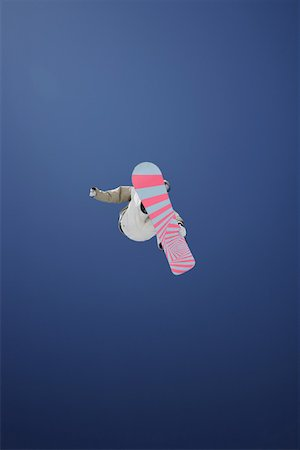 Snowboarder Flying Through the Air Stock Photo - Premium Royalty-Free, Code: 622-01695696