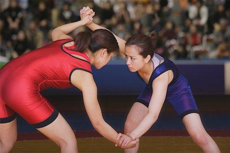 Two Wrestlers Fighting Stock Photo - Premium Royalty-Free, Code: 622-01956258