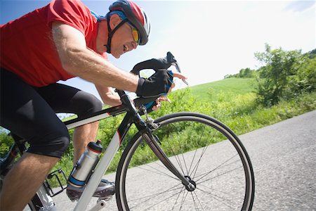 forward - Side view of a man cycling on road Stock Photo - Premium Royalty-Free, Code: 622-02198574