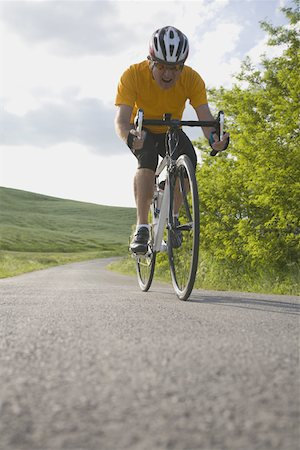 forward - Front view of a man cycling on road Stock Photo - Premium Royalty-Free, Code: 622-02198580