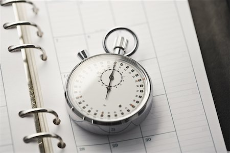 stop watch - Open diary with stopwatch Stock Photo - Premium Royalty-Free, Code: 622-02354349