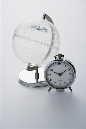 Studio shot of globe with alarm clock Stock Photo - Premium Royalty-Free, Code: 622-02354370