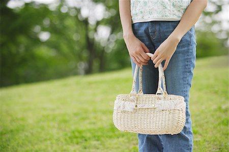 Woman holding white purse Stock Photo - Premium Royalty-Free, Code: 622-02395554