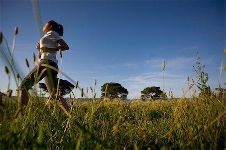 Teenager girl jogging in countryside Stock Photo - Premium Royalty-Free, Code: 622-02621566