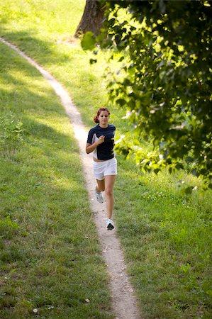 Teenage Girl Running on a Track Stock Photo - Premium Royalty-Free, Code: 622-02621573