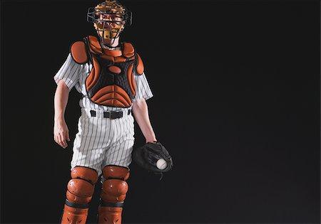professional baseball game - Baseball catcher holding ball in mitt Stock Photo - Premium Royalty-Free, Code: 622-02621706