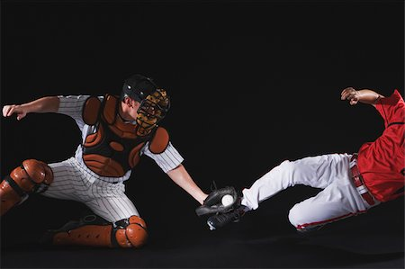 professional baseball game - Baseball player sliding into a base Stock Photo - Premium Royalty-Free, Code: 622-02621707