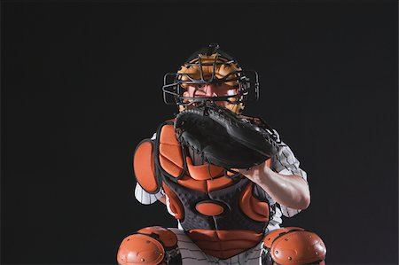 professional baseball game - Baseball catcher waiting for ball Stock Photo - Premium Royalty-Free, Code: 622-02621709
