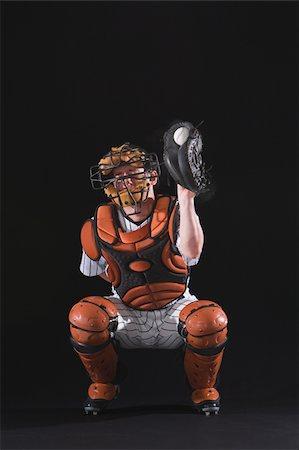 professional baseball game - Baseball catcher holding ball in mitt Stock Photo - Premium Royalty-Free, Code: 622-02621716