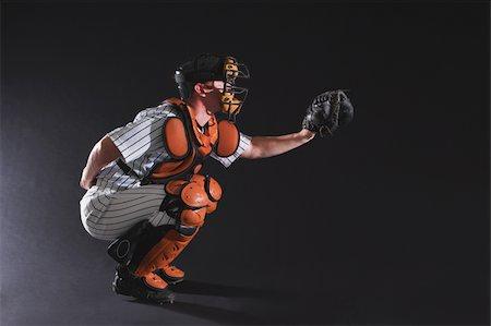 professional baseball game - Baseball umpire in crouching position Stock Photo - Premium Royalty-Free, Code: 622-02621712