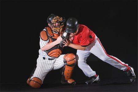 professional baseball game - Baseball player sliding into a base Stock Photo - Premium Royalty-Free, Code: 622-02621724