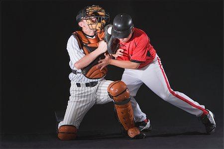professional baseball game - Baseball player sliding into a base Stock Photo - Premium Royalty-Free, Code: 622-02621725