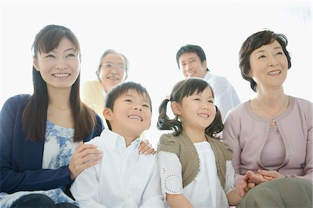 Asian family sitting together Stock Photo - Premium Royalty-Free, Code: 622-02759116