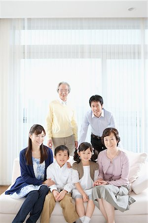 Asian family posing together and looking at camera Stock Photo - Premium Royalty-Free, Code: 622-02759150