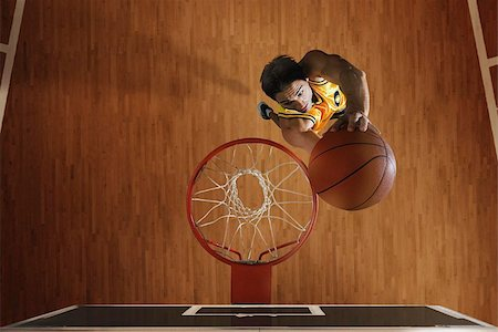 scoring - Young man dunking basketball in hoop Stock Photo - Premium Royalty-Free, Code: 622-02913438