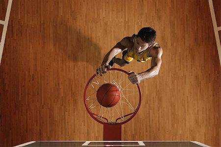 scoring - Young man dunking basketball in hoop Stock Photo - Premium Royalty-Free, Code: 622-02913447