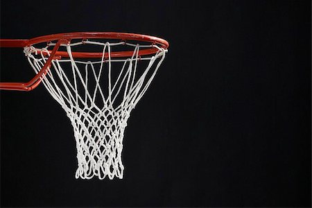 Empty basketball hoop against black background Stock Photo - Premium Royalty-Free, Code: 622-02913451