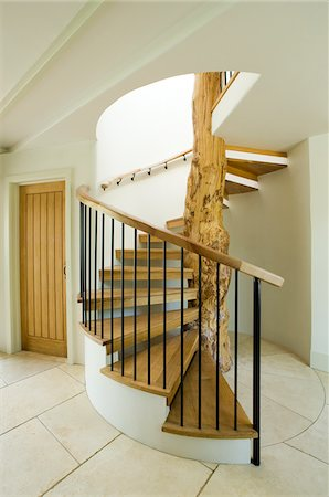 spiral - Modern staircase built around tree Stock Photo - Premium Royalty-Free, Code: 635-05550013