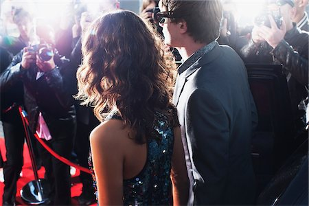 Celebrities posing for paparazzi on red carpet Stock Photo - Premium Royalty-Free, Code: 635-05550035