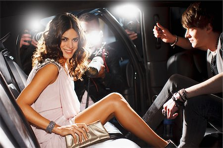 Celebrities emerging from car towards paparazzi Stock Photo - Premium Royalty-Free, Code: 635-05550039