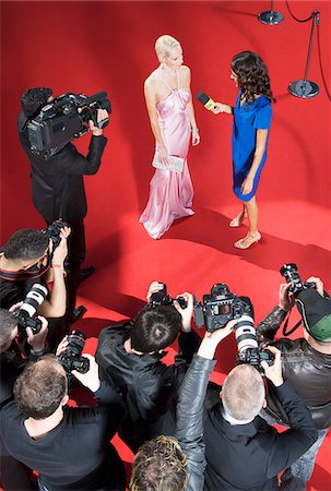 Celebrity talking to reporter on red carpet Stock Photo - Premium Royalty-Free, Code: 635-05550045