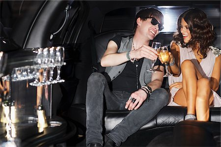 Couple toasting each other in backseat of limo Stock Photo - Premium Royalty-Free, Code: 635-05550049