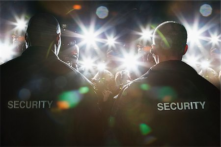Security guards blocking paparazzi Stock Photo - Premium Royalty-Free, Code: 635-05550043