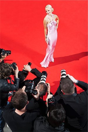 Celebrity posing for paparazzi on red carpet Stock Photo - Premium Royalty-Free, Code: 635-05550054