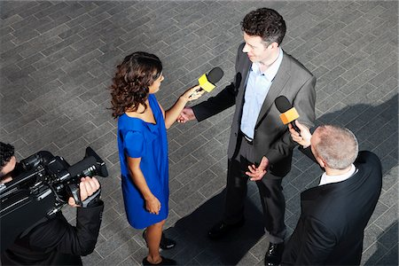 report - Politician talking to reporters Stock Photo - Premium Royalty-Free, Code: 635-05550056
