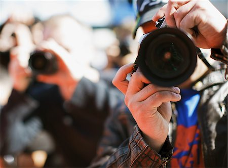 Close up of paparazzo's lens Stock Photo - Premium Royalty-Free, Code: 635-05550052