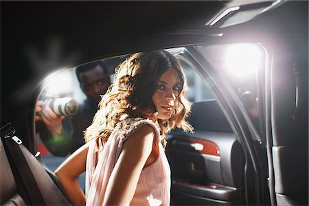 Celebrity emerging from car towards paparazzi Stock Photo - Premium Royalty-Free, Code: 635-05550068