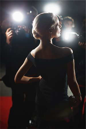 Celebrity posing for paparazzi on red carpet Stock Photo - Premium Royalty-Free, Code: 635-05550061
