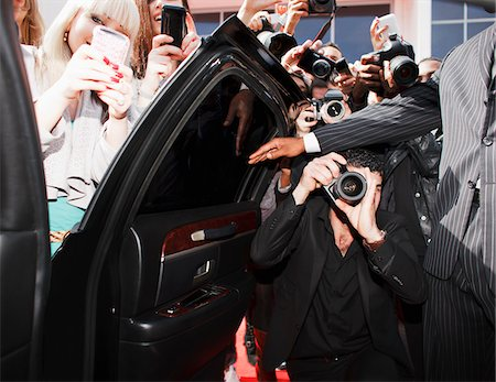 Paparazzi and fans taking photos inside car door Stock Photo - Premium Royalty-Free, Code: 635-05550074
