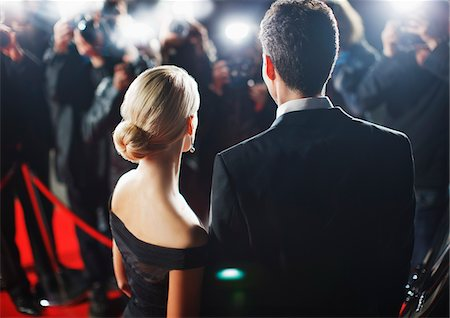 Celebrities posing for paparazzi on red carpet Stock Photo - Premium Royalty-Free, Code: 635-05550076