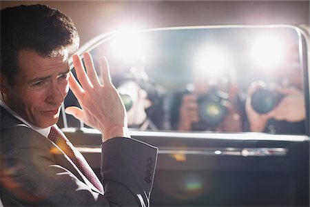 rich lifestyle - Politician shielding himself from paparazzi Stock Photo - Premium Royalty-Free, Code: 635-05550085