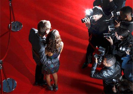 Celebrities posing for paparazzi on red carpet Stock Photo - Premium Royalty-Free, Code: 635-05550081