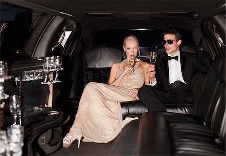 Couple drinking champagne in limo Stock Photo - Premium Royalty-Free, Code: 635-05550082